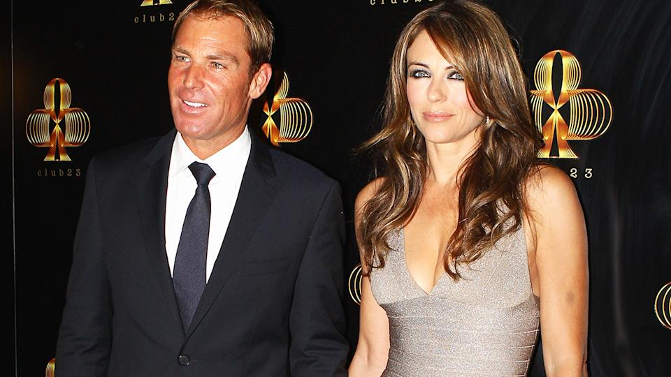 Shane Warne and Liz Hurley, pictured here at the official opening of 'Club 23' in Melbourne in 2011.