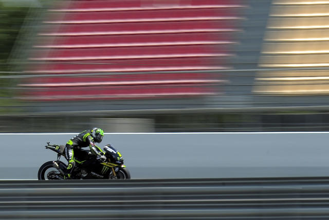 Monster Yamaha Tech 3's British Cal Crutchlow rides at the Catalunya racetrack in Montmelo, near Barcelona, on June 2, 2012, during the MotoGP qualifying session of the Catalunya Moto GP Grand Prix. AFP PHOTO / JOSEP LAGOJOSEP LAGO/AFP/GettyImages