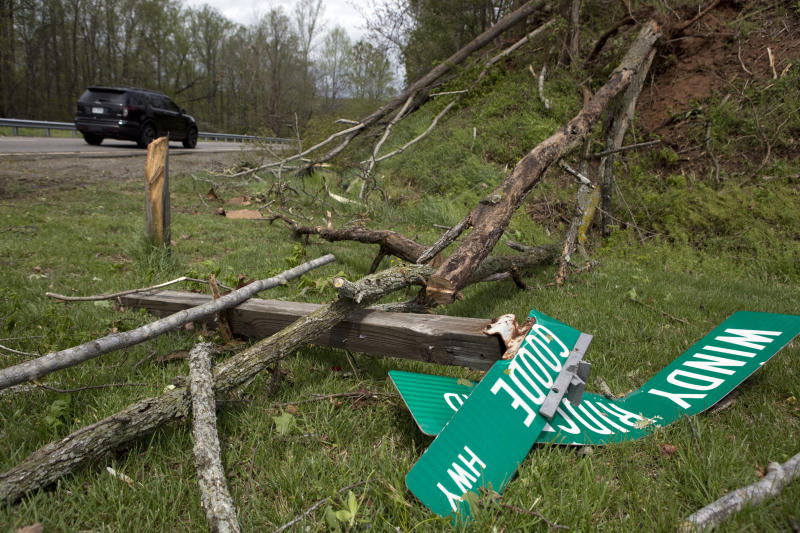 Fallen trees and street signs litter the grass off Highway 220 North after a tornado touched down in Franklin County, Va., Friday, April 19, 2019. (Heather Rousseau/The Roanoke Times via AP)