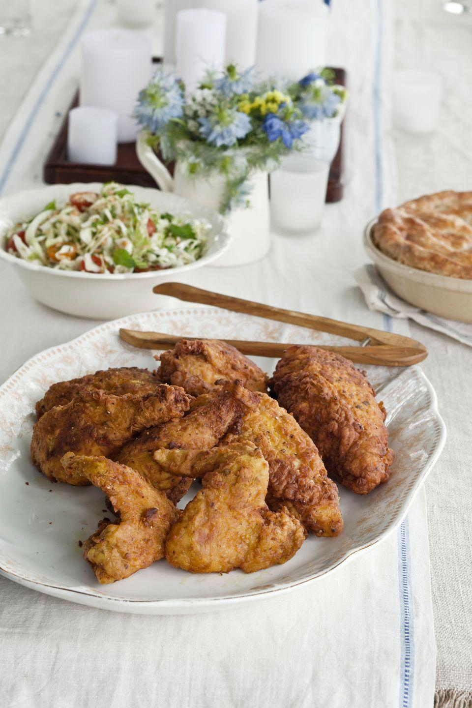 """<p>The fried chicken owes its spice to a buttermilk brine with garam masala, coriander, ginger, and cayenne.</p><p><strong><a href=""""https://www.countryliving.com/food-drinks/recipes/a4166/buttermilk-brined-fried-chicken-masala-recipe-clv0712/"""" rel=""""nofollow noopener"""" target=""""_blank"""" data-ylk=""""slk:Get the recipe"""" class=""""link rapid-noclick-resp"""">Get the recipe</a>.</strong></p>"""