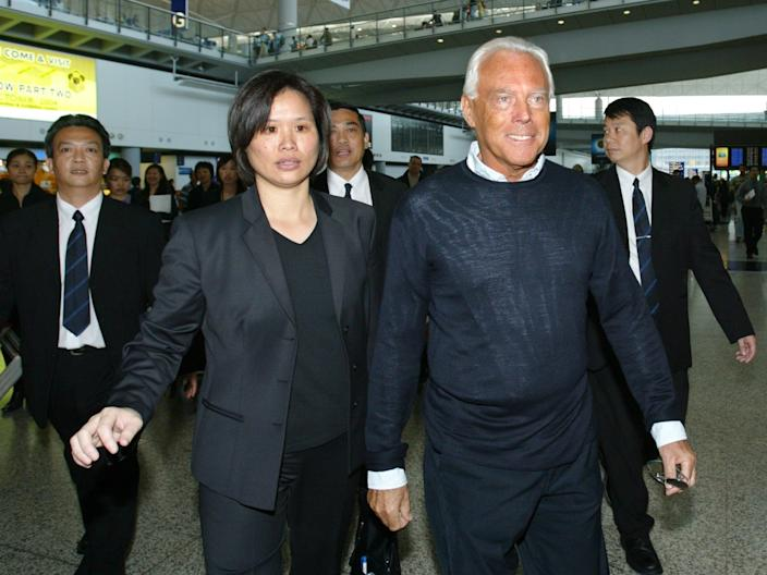 "Armani arrives at Hong Kong airport in 2004. <p class=""copyright"">Reuters</p>"