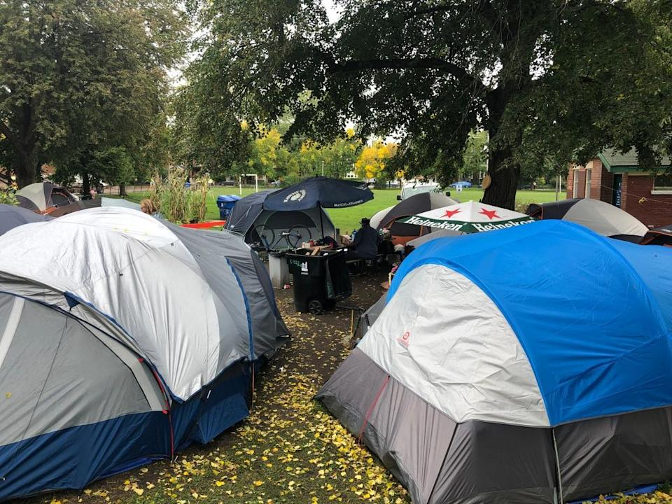 Alykhan Pabani's possessions were removed from the homeless encampment at Dufferin Grove Park, where the city says it has removed 18 tents or structures and connected 16 encampment occupants to permanent housing opportunities between Aug. 11 and Sept. 27, 2021.   (CBC/ Dale Manucdoc - image credit)