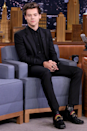 <p>Yes, this <em>looks </em>like a basic black suit, but when paired with rainbow-detailed Gucci boots, it's a Harry-fied hit. (This was a <em>Tonight Show </em>appearance to promote <em>Dunkirk</em>.)</p>