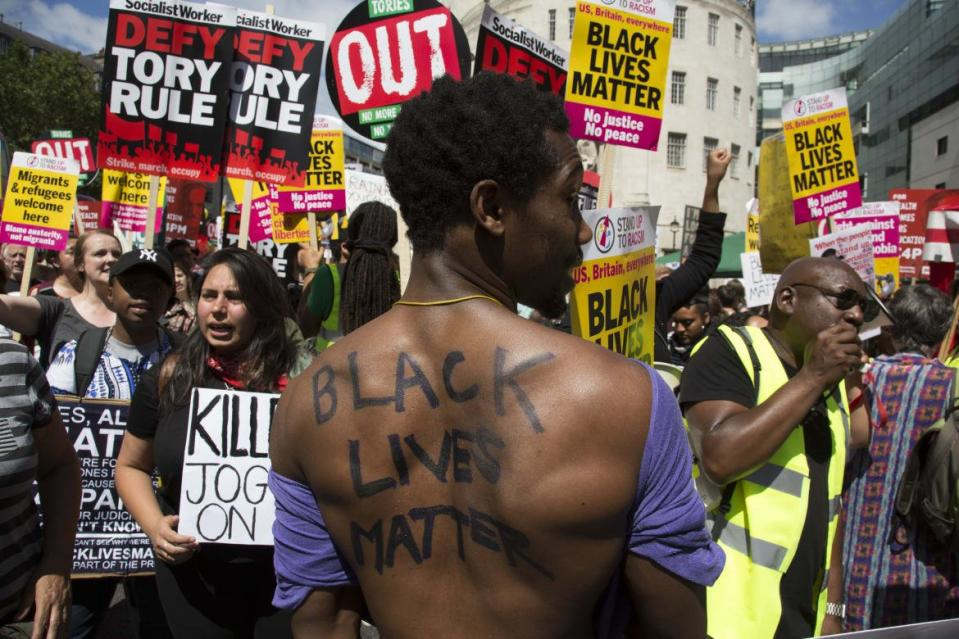 "<div class=""inline-image__caption""><p>Black Lives Matter supporters at the Peoples Assembly demonstration: No More Austerity - No To Racism - Tories Must Go, July 16, 2013 in London. Tens of thousands of people gathered to protest in a march through the capital protesting against the Conservative Party cuts. Almost 150 Councillors from across the country have signed a letter criticizing the Government for funding cuts and and will be joining those marching in London. The letter followed the recent budget in which the Government laid out plans to cut support for disabled people while offering tax breaks for big business and the wealthy.</p></div> <div class=""inline-image__credit"">Mike Kemp/Getty</div>"