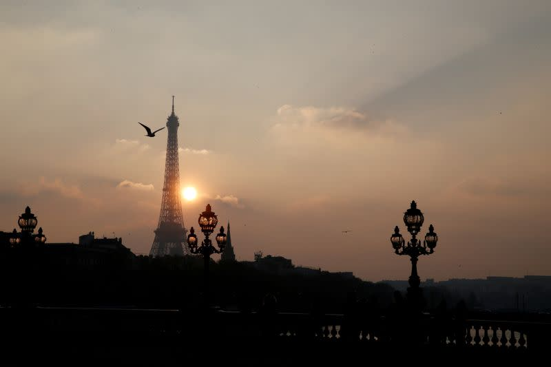 FILE PHOTO: The Eiffel tower is pictured as the sun sets on a winter day in Paris