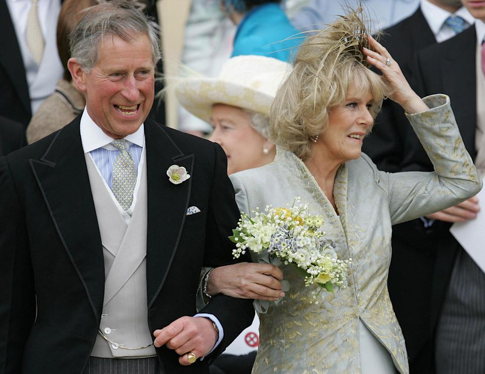 Windsor, UNITED KINGDOM:  Britain's Prince Charles and his bride Camilla, Duchess of Cornwall leave St. George's Chapel in Windsor following the church blessing of their civil wedding ceremony, 09 April 2005. Prince Charles married Camilla Parker Bowles, the true love of his life, on Saturday in a private civil ceremony that inevitably paled against his storybook wedding to Princess Diana more than 20 years ago. AFP PHOTO/Alastair Grant/WPA POOL/AP  (Photo credit should read Alastair Grant/AFP via Getty Images)
