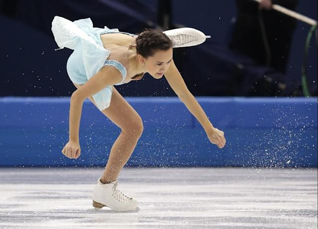 Anne Line Gjersem of Norway competes in the women's short program figure skating competition at the Iceberg Skating Palace during the 2014 Winter Olympics, Wednesday, Feb. 19, 2014, in Sochi, Russia. (AP Photo/Bernat Armangue)