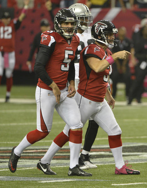 Atlanta Falcons kicker Matt Bryant (3) and Atlanta Falcons punter Matt Bosher (5) react after Bryant kicked a 55-yard long field goal during the second half of an NFL football game against the Oakland Raiders, Sunday, Oct. 14, 2012, in Atlanta. (AP Photo/Rich Addicks)