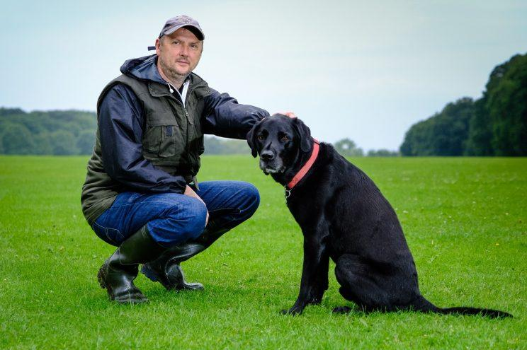 A lucky labrador made a miraculous recovery after a tumour the size of a rugby ball was removed from his chest