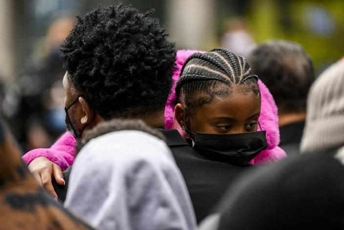 Gianna Floyd (C), daughter of George Floyd, is held during a press conference outside the Hennepin County Government Center on April 19, 2021 in Minneapolis, Minnesota