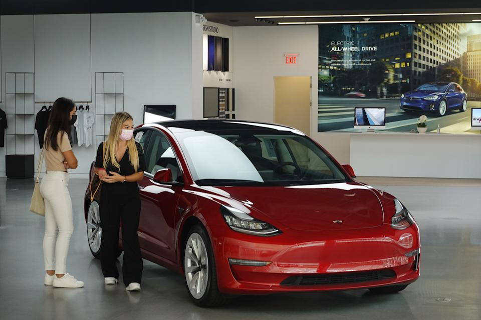 MIAMI, FLORIDA - MARCH 19: A Tesla vehicle is on display at a showroom in the Aventura Mall on March 19, 2021 in Miami, Florida. Reports indicate that China may ban Tesla vehicles from military bases due to possible Chinese government concerns that potentially sensitive data from its onboard cameras could be collected and sent to the United States.  (Photo by Joe Raedle/Getty Images)