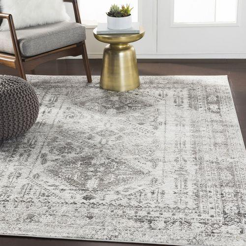 """This is perfectto place in your hallway where you can hear EVERY footstep. This bit of cushioning underfoot will help dampen sound while making the overlooked space look homier.<br /><br /><strong><a href=""""https://boutiquerugs.com/nelsonville-area-rug/"""" target=""""_blank"""" rel=""""noopener noreferrer"""">Get it from Boutique Rugs for $34.12+ (available in eight styles).</a></strong>"""