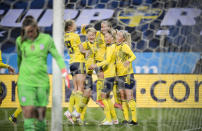 Lina Hurtig, second right, of Sweden celebrate with teammates after scoring the opening goal during the women's international friendly soccer match between Sweden and USA at Friends Arena in Stockholm, Sweden, Saturday, April 10, 2021. (Janerik Henriksson/TT via AP)