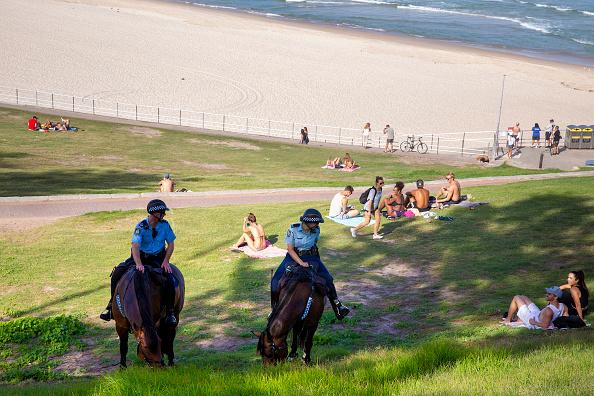 Mounted police officers are seen patrolling Bondi Beach.