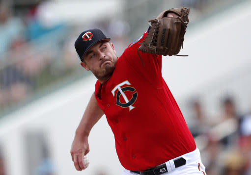 FILE - In this Monday, March 11, 2019 file photo, Minnesota Twins pitcher Addison Reed (43) works against the Detroit Tigers in the fourth inning of a spring training baseball game in Fort Myers, Fla. Relief pitcher Addison Reed has been designated for assignment by the Minnesota Twins following a rocky start to his rehabilitation assignment for a sprained thumb on his non-throwing hand that set him back in spring training. The move was made on Thursday, May 16, 2019 before the Twins played at Seattle, making room on the 40-man roster for right-handed reliever Austin Adams. (AP Photo/John Bazemore, File)