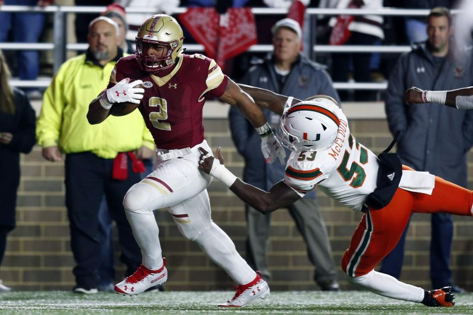 Boston College running back AJ Dillon (2) was a dark horse Heisman candidate early this season before tapering off. (AP)