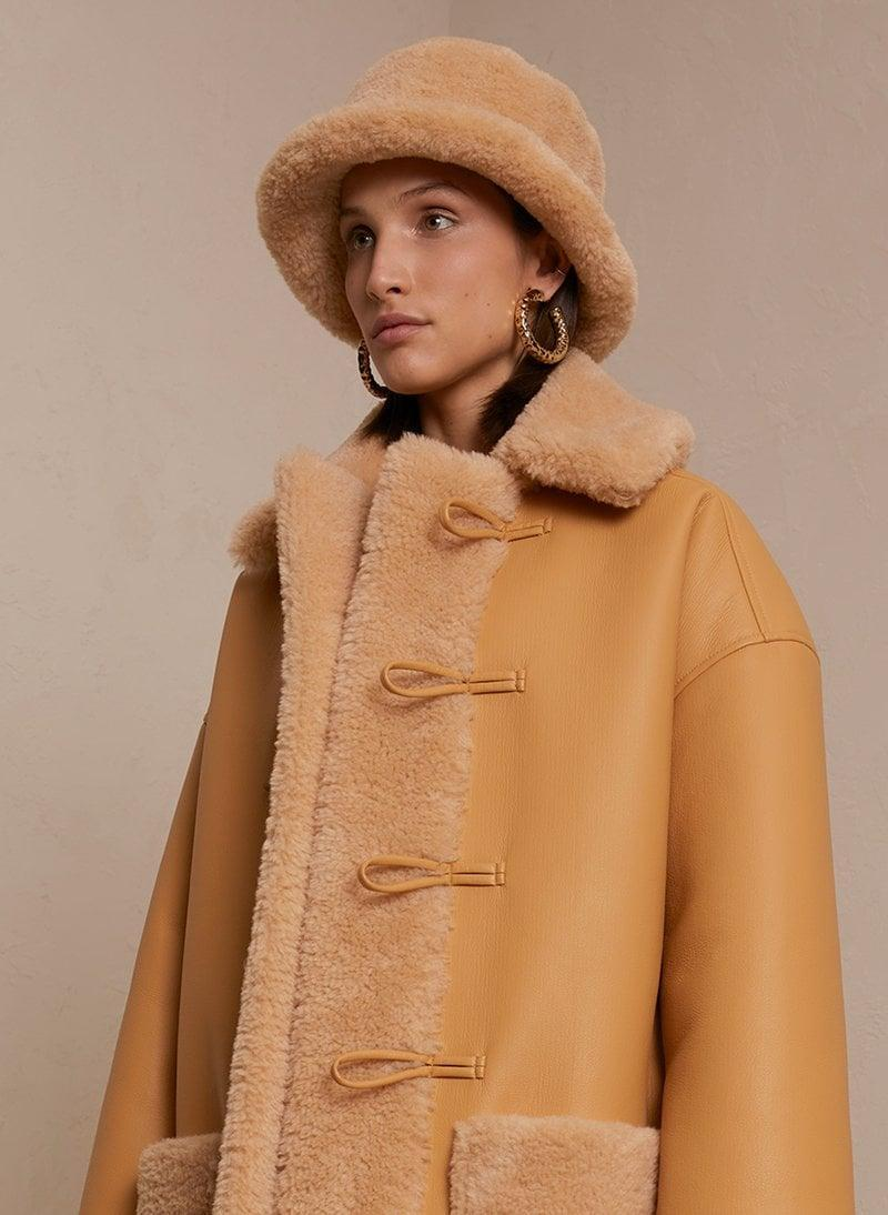 <p>It may be too soon to start wearing bucket hats, but save this <span>Thomas Faux Fur Hat</span> ($135) for when we transition to winter. It looks elevated, modern, and chic.</p>