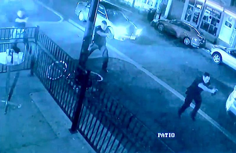 Surveillance footage near Ned Peppers shows police officers responding to the gunman within seconds of his first shot. (Photo: Dayton Police Department)