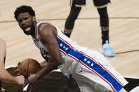 Philadelphia 76ers center Joel Embiid falls to the floor after fouling an Atlanta Hawks player during the first half of Game 6 of an NBA basketball Eastern Conference semifinal series Friday, June 18, 2021, in Atlanta. (AP Photo/John Bazemore)