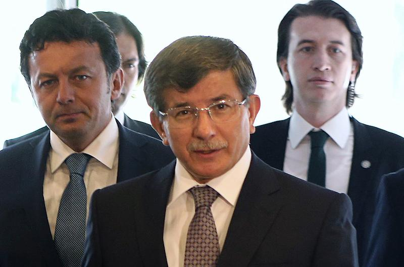Turkey's Foreign Minister Ahmet Davutoglu (C) arrives for a meeting in Ankara, on August 20, 2014