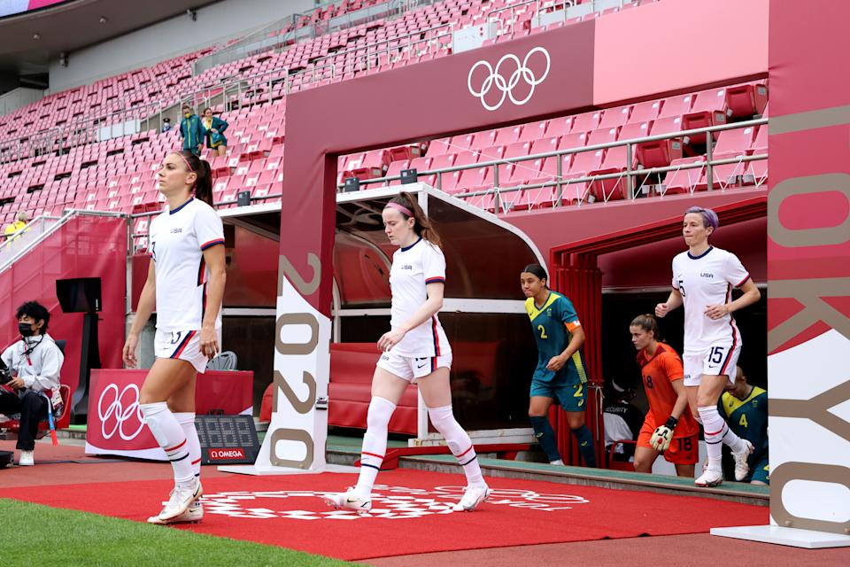Alex Morgan, Rose Lavelle and Megan RapiThe USWNT Players Association received a $1 million check from a women's apparel company amid their equal pay fight. (Atsushi Tomura/Getty Images)noe enter the pitch.