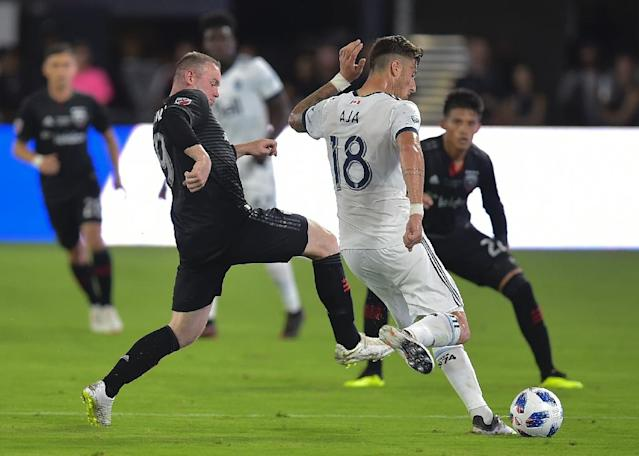 Wayne Rooney (L) of DC United said he likes how football is growing in America and says it might one day rival such leagues as the NFL and NBA (AFP Photo/ANDREW CABALLERO-REYNOLDS)