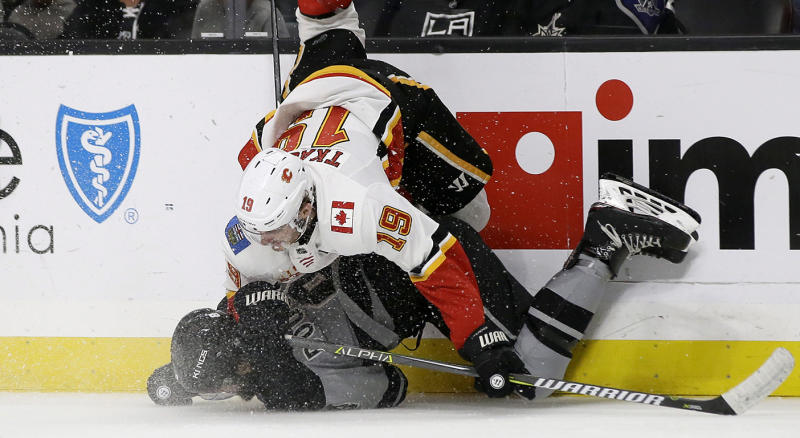 Los Angeles Kings defenseman Drew Doughty, bottom, upends Calgary Flames left wing Matthew Tkachuk, above, during the third period of an NHL hockey game in Los Angeles, Saturday, Oct. 19, 2019. (AP Photo/Alex Gallardo)
