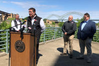 Tennessee Department of Transportation chief engineer Paul Degges, at podium, talks about a crack in the Interstate 40 bridge that connects Arkansas and Tennessee, Wednesday, May 12, 2021, in Memphis, Tenn. The crack, found Tuesday, has forced the closure of the bridge for an indefinite period of time. (AP Photo/Adrian Sainz)
