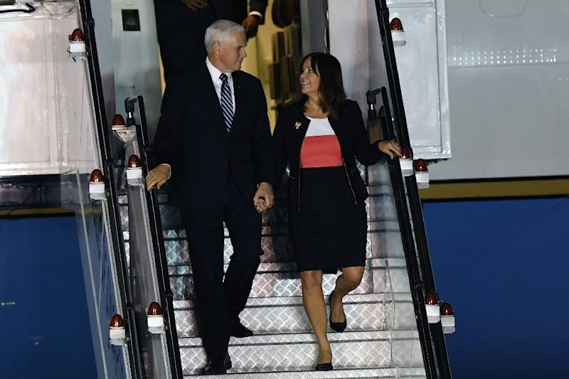 Mike and Karen Pence, who met at church, are often seen holding hands when they are making a public appearance (AFP Photo/Lillian SUWANRUMPHA)