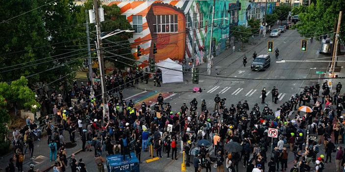 Police face off with demonstrators during protests in Seattle on July 25, 2020 in Seattle, Washington. Police and demonstrators clash as protests continue in the city following reports that federal agents may have been sent to the city.