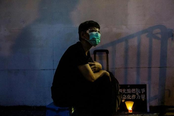 Activists wore face masks as they defied a corinavirus ban on gatherings (AFP Photo/ISAAC LAWRENCE)