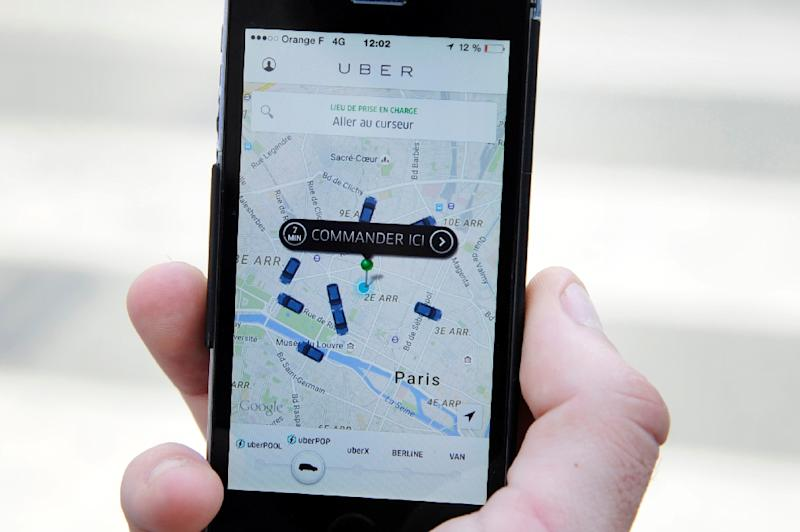 Uber app-based service gave millions of car owners around the world the chance to make money ferrying passengers without taxicab licenses or other permissions (AFP Photo/Thomas Oliva)