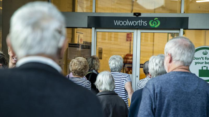 Most Woolworths stores in Victoria have Community Pick Up still available. Pictured are shoppers outside one of the stores.