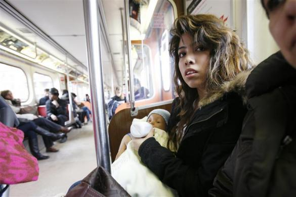 High school student Jessica Garcia, 16, tends to a baby doll for her parenting class on the subway in Toronto, Ontario, March 3, 2012. The baby doll requires regular feeding and many other attentions a real baby needs.