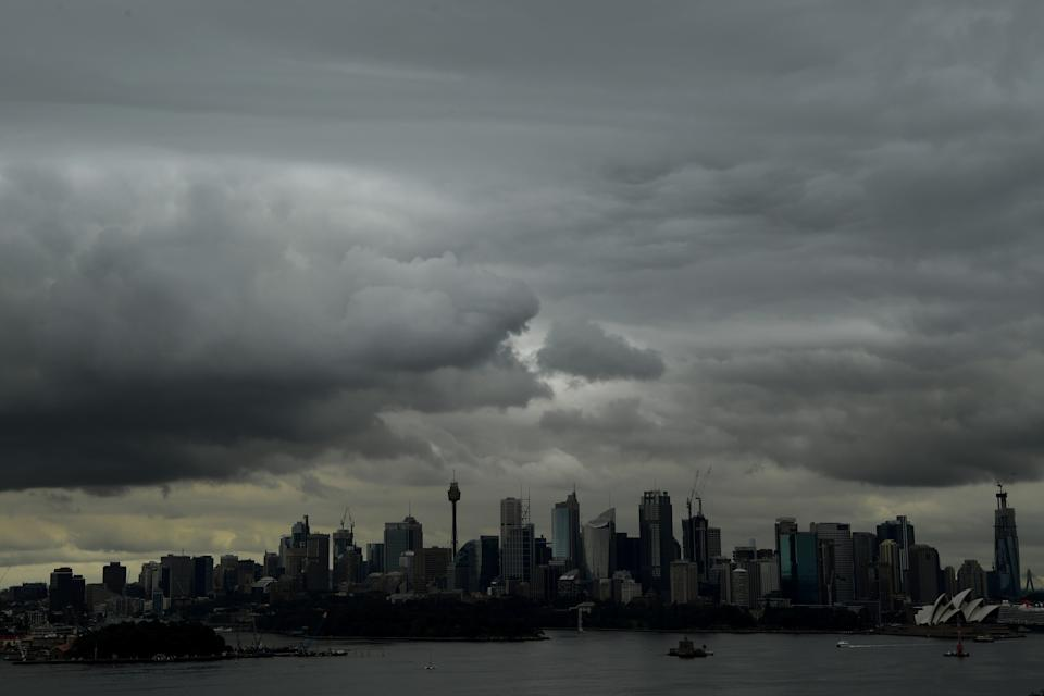 Storm clouds are seen over the central business district from Taronga Zoo in Sydney. Source: AAP