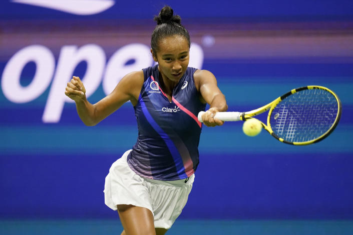 Leylah Fernandez, of Canada, returns a shot to Aryna Sabalenka,of Belarus, during the semifinals of the US Open tennis championships, Thursday, Sept. 9, 2021, in New York. (AP Photo/Seth Wenig)