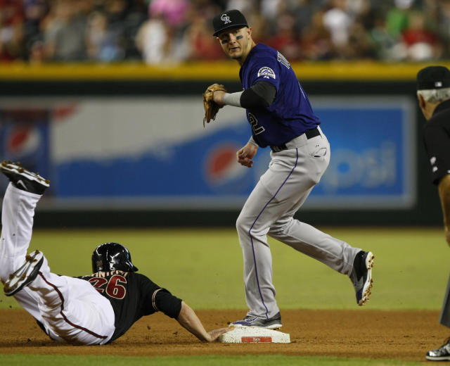 Colorado Rockies shortstop Troy Tulowitzki (2) gets the force-out on Arizona Diamondbacks Miguel Montero (26) in the fourth inning during a baseball game on Saturday, Sept. 14, 2013, in Phoenix. (AP Photo/Rick Scuteri)