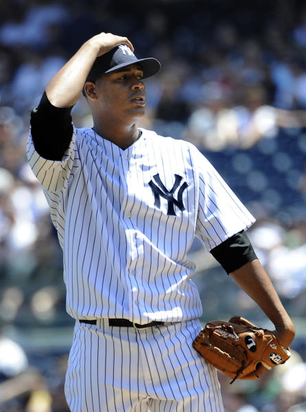 New York Yankees starting pitcher Ivan Nova reacts after he walks Cincinnati Reds' Joey Votto in the first inning of a baseball game on Saturday, May 19, 2012, at Yankee Stadium in New York. The Reds won 6-5. (AP Photo/Kathy Kmonicek)