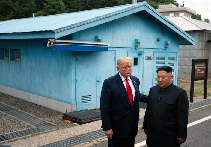 President Donald Trump and North Korean leader Kim Jong-un stand on the South Korean side of the Demilitarized Zone between North and South Korea on June 30, 2019. (Erin Schaff/The New York Times)