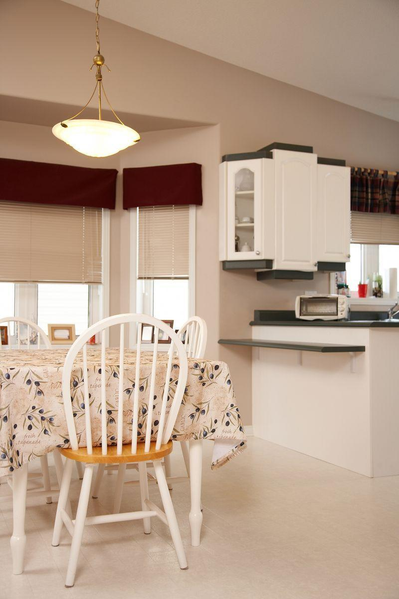 <p>Whether it's used in a kitchen or dining area, linoleum flooring is just unacceptable. Do yourself a favor and upgrade to a more practical material like wood or tile. </p>