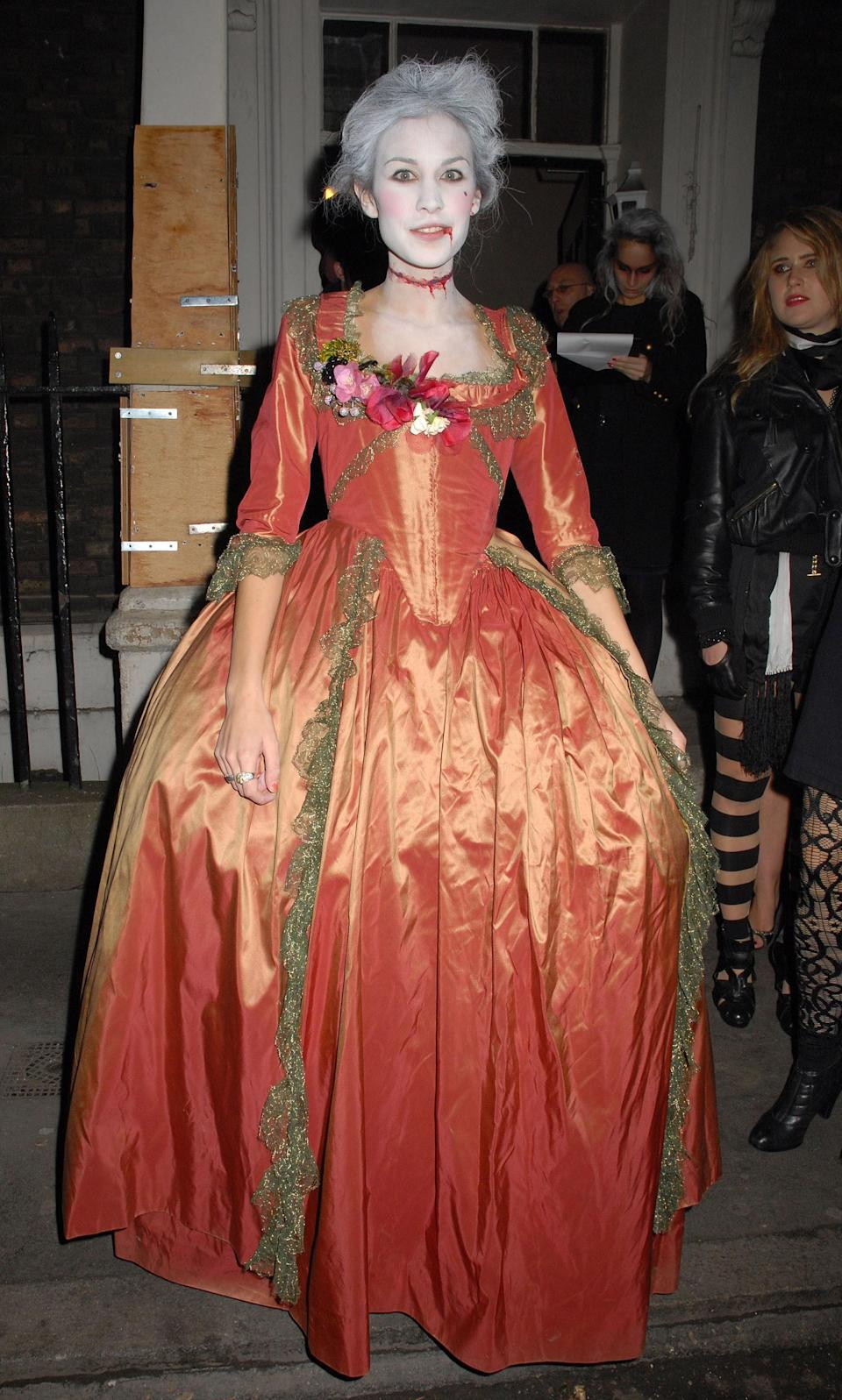 We're just wondering if she stood up the whole night in that hoop skirt.