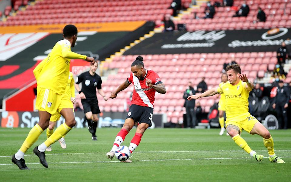 Theo Walcott shapes to shoot before making it 3-1 to Southampton - GETTY IMAGES