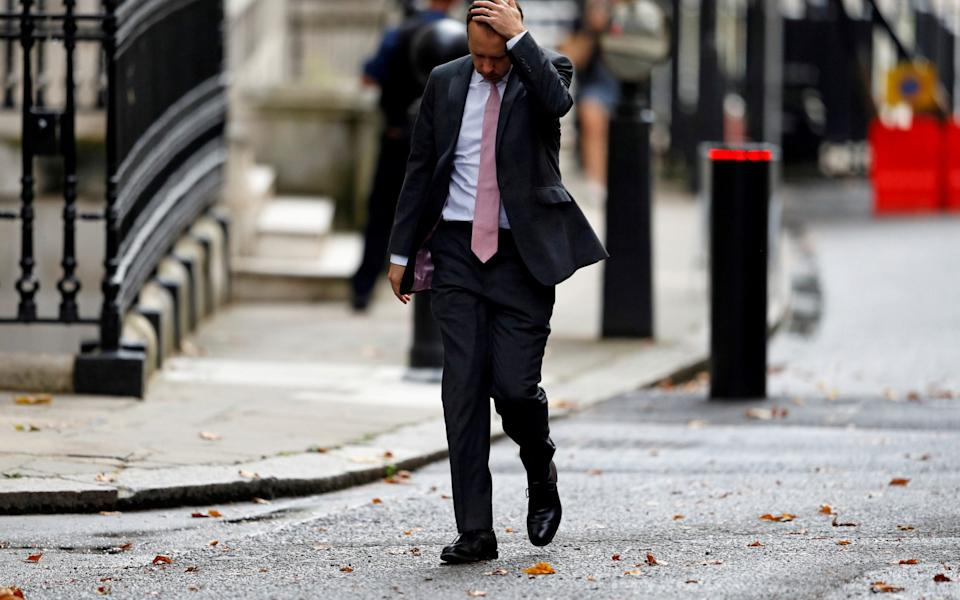 Britain's Health Secretary Matt Hancock walks outside Downing Street in London - Reuters