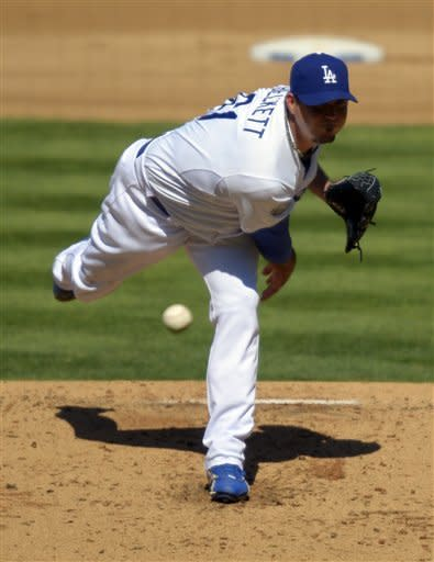 Los Angeles Dodgers starting pitcher Josh Beckett throws to the plate during the second inning of their baseball game against the Colorado Rockies, Sunday, Sept. 30, 2012, in Los Angeles. (AP Photo/Mark J. Terrill)