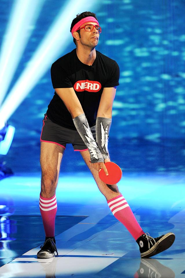 """BEST: Zach Levi Plays Ping-Pong — Zachary Levi popping up out of the crowd in short shorts and knee socks — it's what every award show should require from now on. The """"<a href=""""/chuck/show/40464"""">Chuck</a>"""" star wasn't promoting anything, but, well, there he was! He then proceeded to gallop up to the stage, stretch his legs, and play a little game of Ping-Pong with Cuoco. Yes, it was silly, but it was a cute moment in a night of forced interactions. Also, he randomly called out Bieber after a missed shot — """"That's a warning for you, Bieber!"""" Anyone who does that is our hero. The whole thing was over pretty quickly, too, and that's always good."""