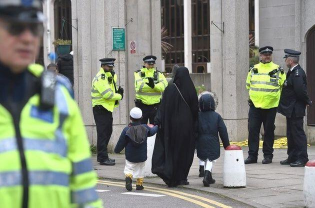 Worshippers arrive for midday prayers at the London Central Mosque