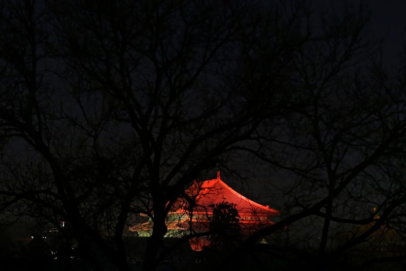 The Forbidden City is projected with colorful lights during the Lantern Festival in Beijing, Tuesday, Feb. 19, 2019. (Photo: Andy Wong/AP)