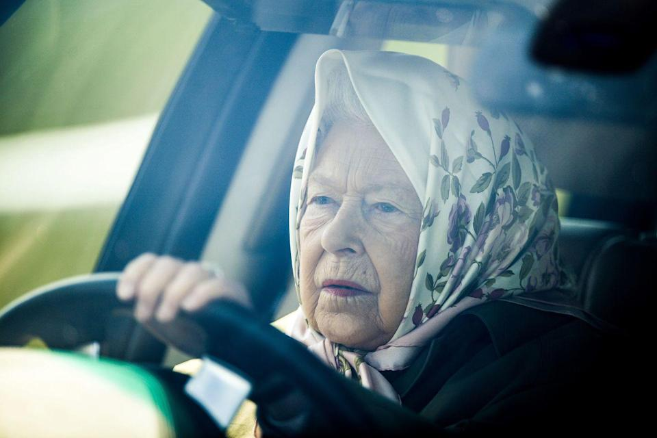<p>At the annual Royal Windsor Horse Show, the Queen arrived wearing a floral headscarf, driving her signature Range Rover. </p>