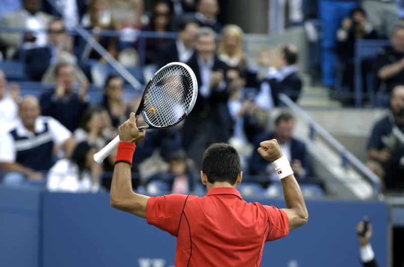 Novak Djokovic, of Serbia, reacts after a 54 shot rally against Rafael Nadal, of Spain, during the men's singles final of the 2013 U.S. Open tennis tournament, Monday, Sept. 9, 2013, in New York. (AP Photo/Darron Cummings)