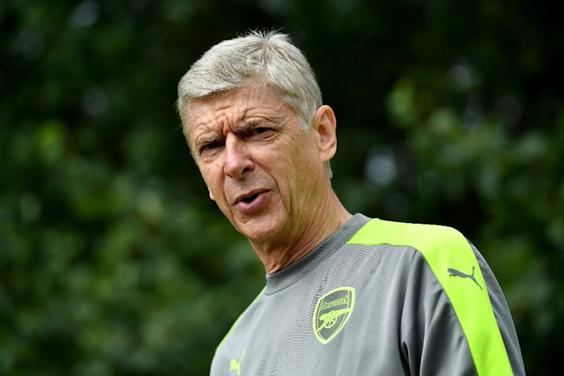 Arsenal's French manager Arsene Wenger arrives for a training session at Arsenal's London Colney training ground
